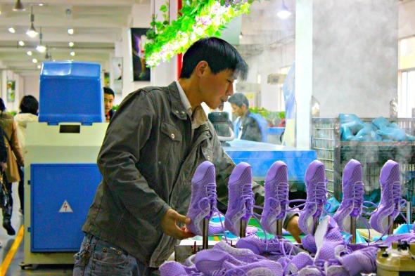 Heating up shoes in Anta Shoe factory in Fujian, China